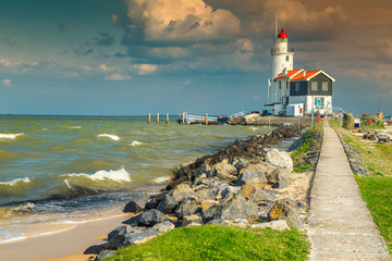 Spectacular seascape with famous lighthouse in Marken, Netherlands, Europe