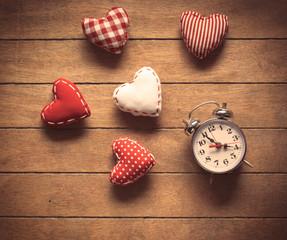 Classic alarm clock and heart shape toys