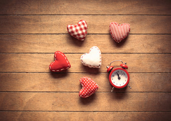 Classic alarm clock and heart shape toys