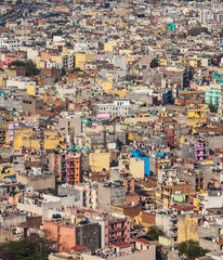 Top view on chaos of colored buildings - the heap of houses in the Asian cities caused by big overpopulation.