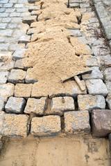 cobblestone street under renovation
