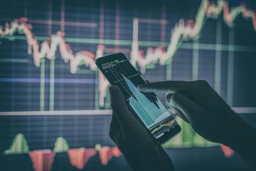 Businessman checking stock market data.