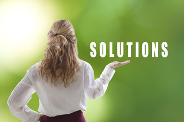 young woman holding the concept of solutions