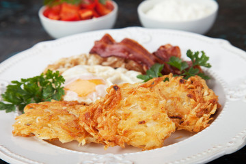 Hash browns with egg and bacon