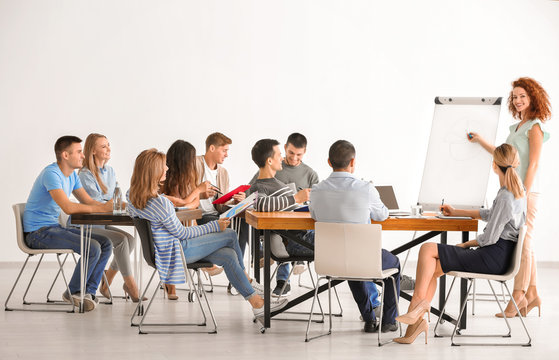 Group of people with business trainer at seminar