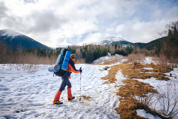 Man hiking in beautiful winter mountain