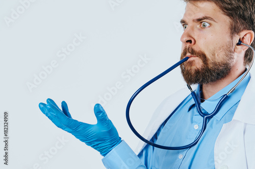 Man with beard on white isolated background in medical dressing gown ...