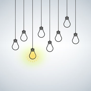 Vector illustration with hanging light bulbs. One light bulb is on