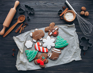 A preparation and making cookies for Christmas party on a wooden background.
