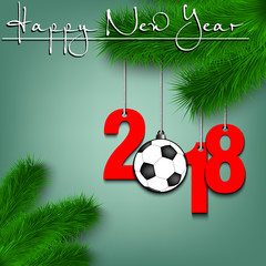 Soccer ball and 2018 on a Christmas tree branch