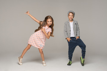 Happy dancing kids. Studio photo.