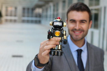 Smiley businessman holding a cyborg