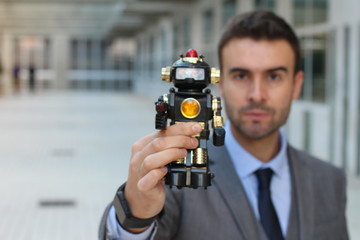 Businessman holding a robot in office space