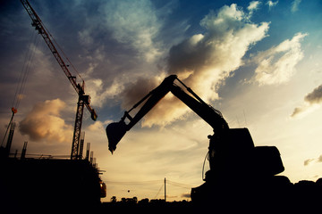 construction equipment's silhouette on sunset