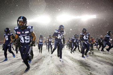 Argonauts run on the field before the start of the Grey Cup in Ottawa