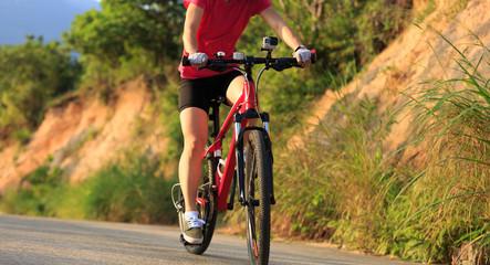 woman cyclist cycling mountain bike on trail