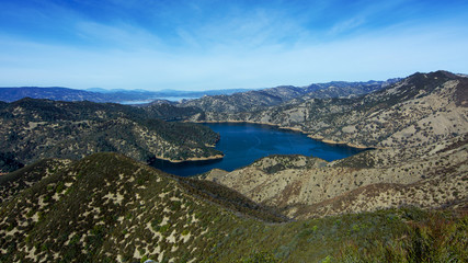 Aerial view of Lake Berryessa from the first viewpoint of the Blue Ridge Trail loop going clockwise, Stebbins Cold Canyon, on a sunny day.