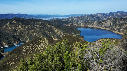Poster Hill Aerial view of Lake Berryessa from the Blue Ridge Trail, Stebbins Cold Canyon, on a sunny day, featuring the surrounding blue oak woodland and the cove marina in the fall of 2017