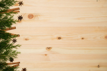 Christmas background. Top view mockup  branches fir tree on wooden desk.