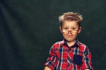 Positive cute little boy posing