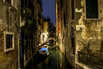 Canal alley with boats and gondola romantic Venice
