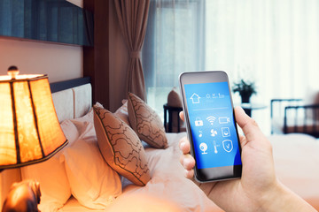 smart phone with smart home with modern bedroom