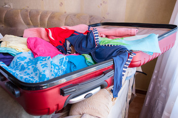 Charges for the journey, an open suitcase with women's things