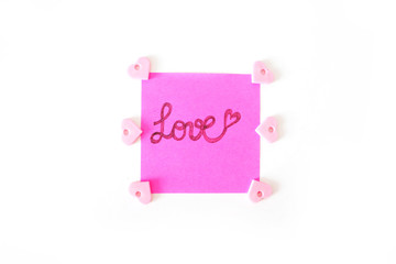 Pink Paper Stick Note With Love Text Written on a White Background Great for Any Use.