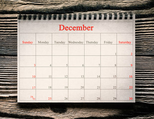December 25 in the calendar on the wood background
