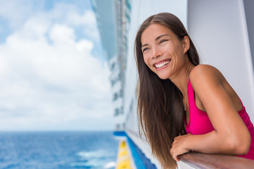 Wall Mural - Cruise ship summer vacation. Travel woman tourist happy on luxury cruise getaway smiling at her holidays. Summer european destination holiday. Asian girl enjoying ocean view from ship.