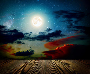 backgrounds night sky with stars, moon and clouds. wood floor