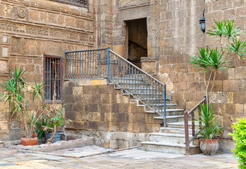 Courtyard of Prince Tax palace with staircase and entrance leading to the first floor located in Old Cairo, Egypt