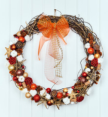 ?hristmas wreath with fir tree, on white wooden background. Christmas wreath from natural ingredients.