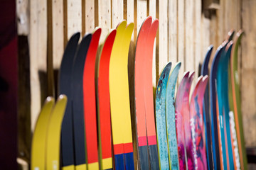 Ski shop sale. Rows of  colourful skis on wooden wall.  Wall mural