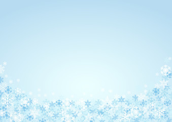 Festive horizontal Christmas background and winter with copy space. snow and ice crystals on blue sky