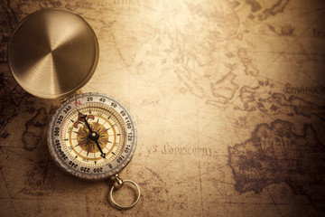 Retro vintage compass with vintage map
