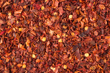 In de dag Kruiden hot chili pepper flakes spice as a background, natural seasoning texture