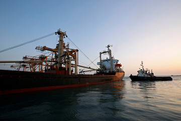 A ship carrying 5,500 tonnes of flour is towed by a tugboat at the Red Sea port of Hodeidah