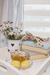 Perfect place for rest with flowers, tea and books