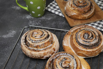 appetizing buns with poppy seeds, homemade pastries, pastry shop.