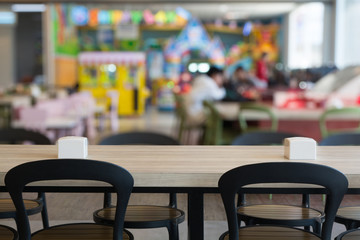 Wooden Table in FastFood or Food Court Center Thailand.