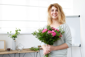 Picture of florist girl making up bouquet