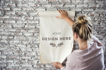 Rear view of woman holding design space paper