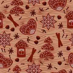 Christmas gingerbread seamless pattern on the background of wood