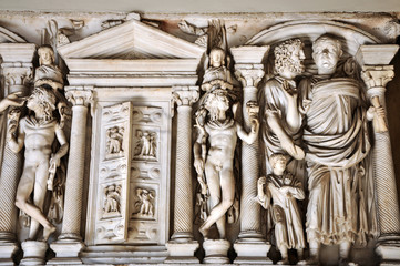 Fototapete - Bas-relief and sculpture details in stone of Roman Gods and Emperors