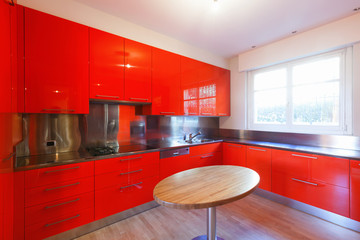Modern kitchen lacquered with red