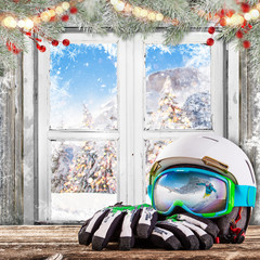 Winter old white window with ski helmet and gloves.