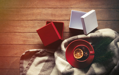 Cup of tea and scarf with present boxes