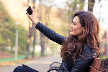 Stylish modern girl taking a selfie