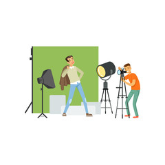 Photographer taking picture of young man model. Professional studio with equipment soft box, spotlight, green backdrop and camera on tripod. Flat vector
